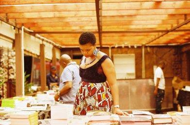 Captured at Abantu Book Festival browsing book titles, Malebo Sephodi. Photo credit: Lidudumalingani